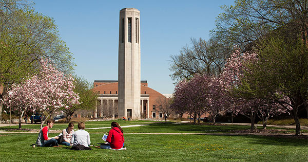 Students sitting by the Mueller belltower